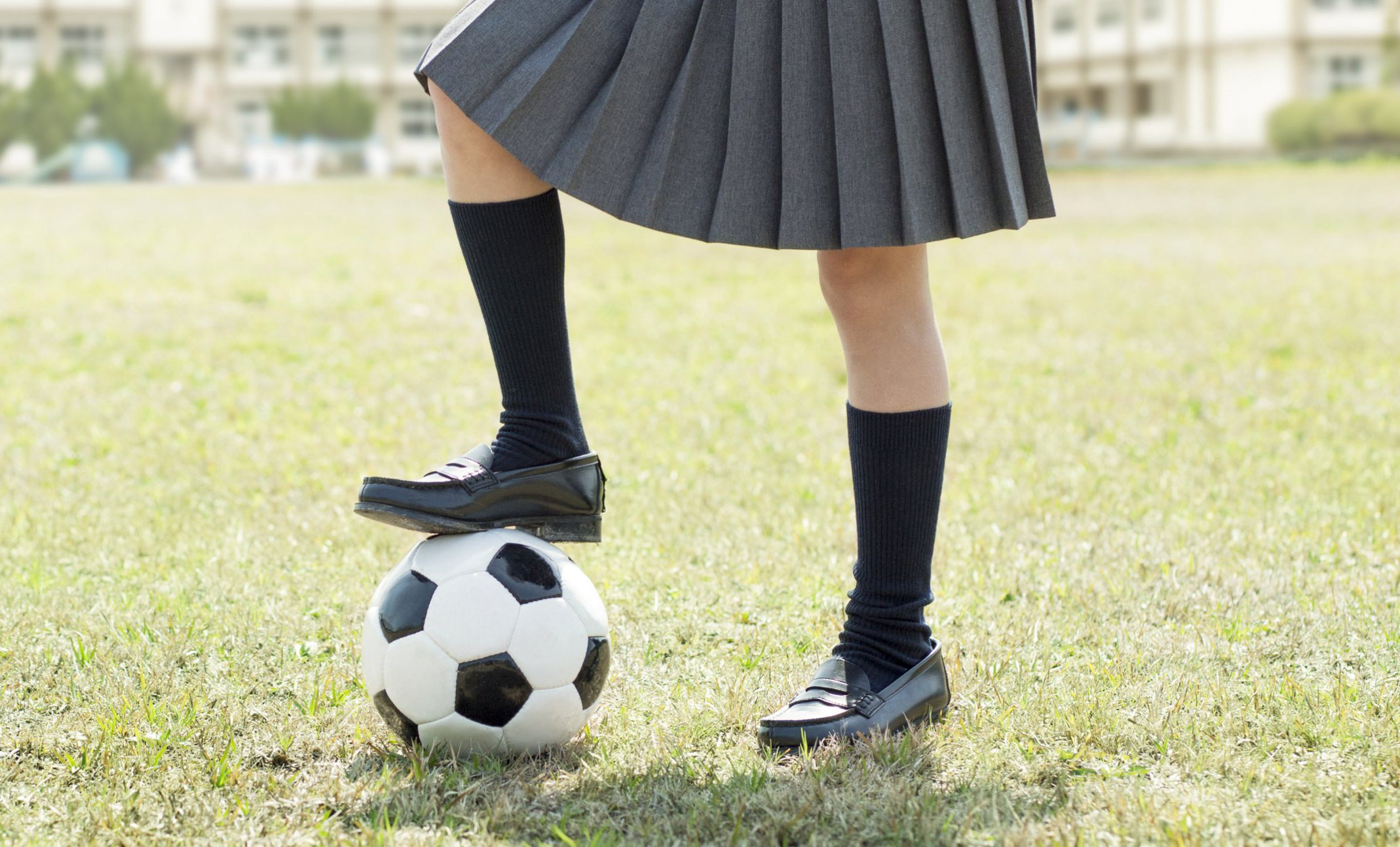 Low Section Of Schoolgirl With Football