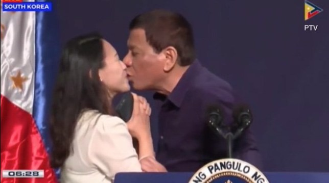 Creepy moment President Duerte kisses married woman on the lips in front of crowd in South korea METRO GRAB taken from: http://video.metro.co.uk/video/met/2018/06/04/4253901537545241529/640x360_MP4_4253901537545241529.mp4 Credit: PTV