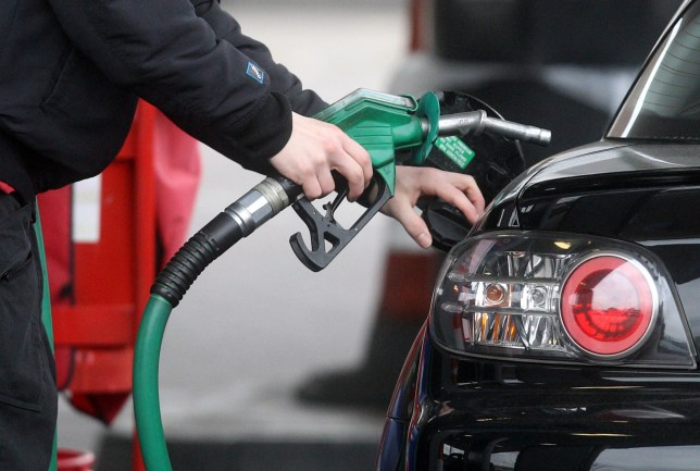 File photo dated 22/02/13 of a person using a petrol pump. Government data reveals that fuel prices have reached a three-and-a-half year high.