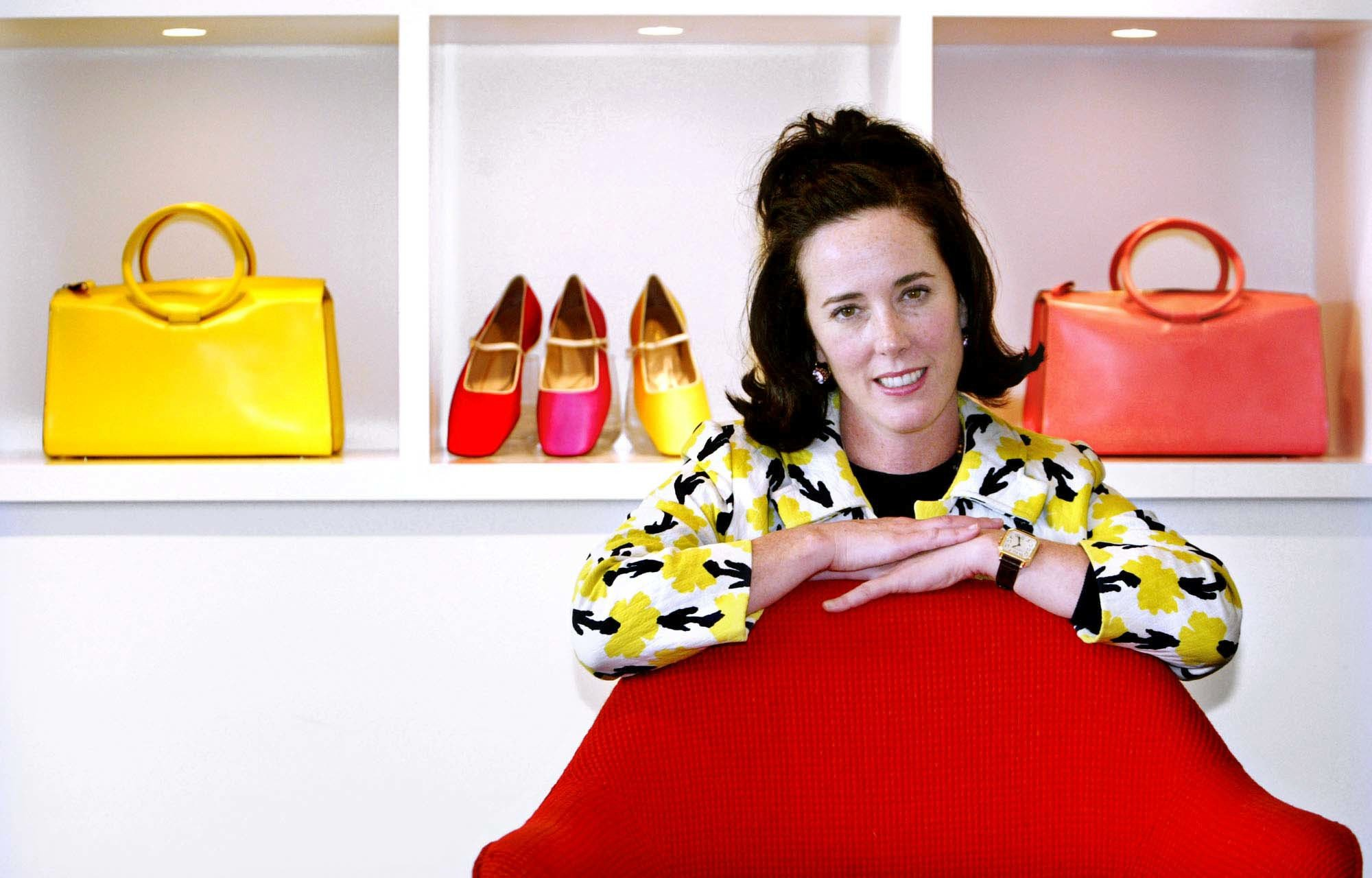 In this May 13, 2004 file photo, designer Kate Spade poses with handbags and shoes from her next collection in New York