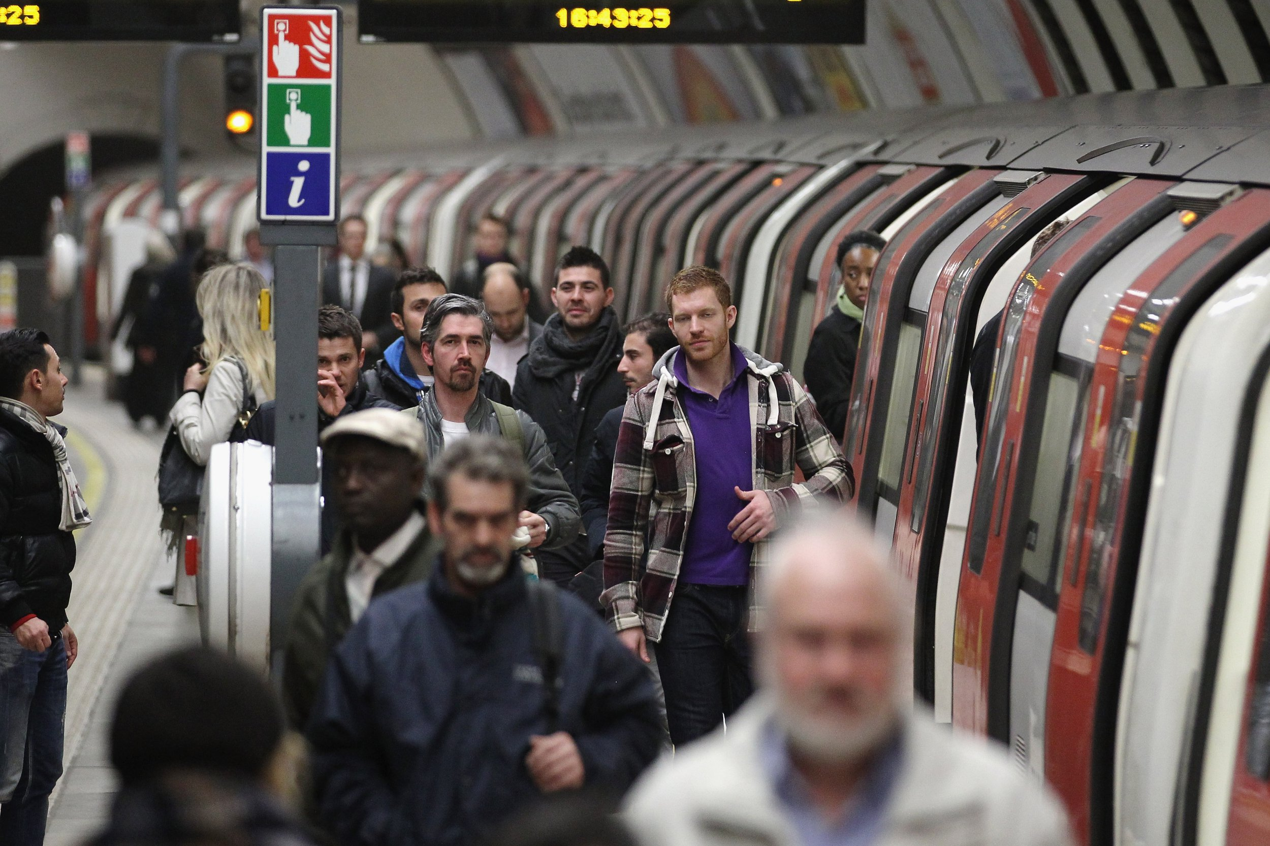 LONDON, ENGLAND - MARCH 05: Commuters make their way along a platform at Clapham North Underground station on March 5, 2012 in London, England. London's underground rail system, commonly called the tube, is the oldest of its kind in the world dating back to 1890. It carries approximately a quarter of a million people around its network every day along its 249 miles of track and 270 stations. The network has undergone several years of upgrade work and refurbishment in preparation for the Olympic Games which take place this summer. During this time the tube is expected to carry millions of visitors to and from the Olympic Parks. (Photo by Dan Kitwood/Getty Images)