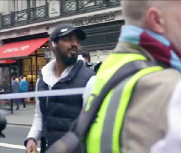 "BEST QUALITY AVAILABLE Handout CCTV still issued by the Metropolitan Police of Khalid Ali (left) carrying out reconnaissance in Whitehall during a march on March 18, 2017, shown to the court during his trial at the Old Bailey. PRESS ASSOCIATION Photo. Issue date: Tuesday June 5, 2018. The scared mother of a British Taliban fighter reported him to police just hours before he allegedly set out to cause carnage in Westminster, a court heard. Khalid Ali, 28, spent five years making bombs in Afghanistan before returning home to deliver a ""message"" to Parliament armed with three knives, jurors were told. The trained plumber was arrested in Parliament Square on April 27 last year, four weeks after the murderous attack by Khalid Masood. See PA story COURTS Westminster. Photo credit should read: Metropolitan Police/PA Wire , police and shown in court. PRESS ASSOCIATION Photo. Issue date: Tuesday June 5, 2018. See PA story COURTS Westminster. Photo credit should read: Metropolitan Police/PA Wire NOTE TO EDITORS: This handout photo may only be used in for editorial reporting purposes for the contemporaneous illustration of events, things or the people in the image or facts mentioned in the caption. Reuse of the picture may require further permission from the copyright holder."
