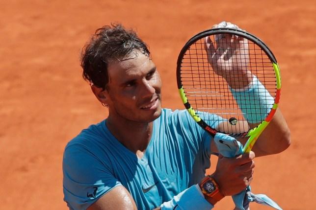 Spain's Rafael Nadal celebrates winning his quarterfinal match of the French Open tennis tournament against Argentina's Diego Schwartzman in four sets 4-6, 6-3, 6-2, 6-2, at the Roland Garros stadium in Paris, France, Thursday, June 7, 2018. (AP Photo/Alessandra Tarantino)