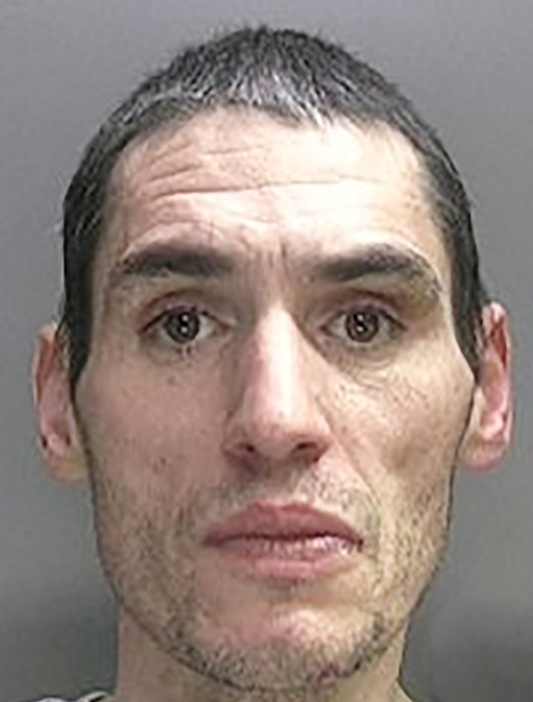 """FILE PICTURE - Nicholas Mason. A 43-year-old man has been arrested on suspicion of attacking an 86-year-old gran who suffered a broken neck and back after she was dragged up the stairs by her ANKLES. See NTI story NTIBURGLAR. Police launched a manhunt for Nicholas Mason who is accused of tricking his way into Veronica Eustace's home in Yardley, Birmingham, by pretending to be a relative. Her family say she opened the door when a man yelled """"nan help"""" from the back door at 6.30am on Tuesday (5/6). Thinking the person was her grandson Barry, she opened the door but was punched to the floor and the intruder barged his way inside. West Midlands Police confirmed Mason was arrested today (Fri) at 9.35am at an address in East Park, Birmingham."""