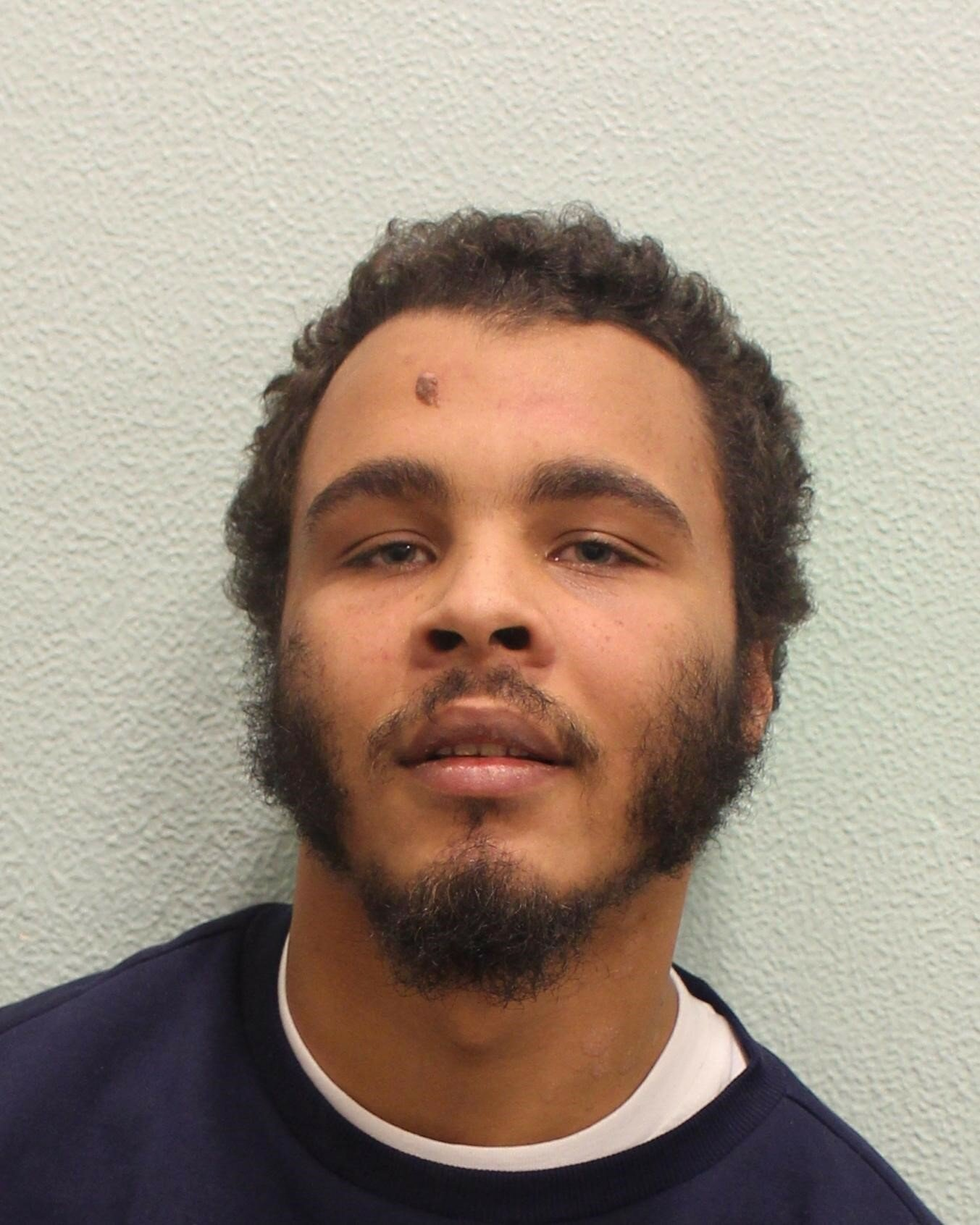 Pic shows Jordan Bailey-Mascoll A moped-riding mugger fought with security guards today (Fri) as he was convicted of stabbing a man to death for his ?7,000 Rolex in front of the victim?s girlfriend. Jordan Bailey-Mascoll, 25, was one of two men who attacked murdered Danny Pearce, 31, as he left Oliver's jazz club in Greenwich, south London. Bailey-Mascoll and an accomplice he refused to name, known as 'Ghost' drove around on a moped, targeting people with expensive watches, Woolwich Crown Court heard. SEE STORY CENTRAL NEWS
