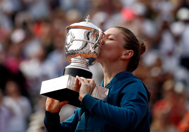 epa06796653 Simona Halep of Romania reacts with the trophy after winning against Sloane Stephens of the USA during their women???s final match during the French Open tennis tournament at Roland Garros in Paris, France, 09 June 2018. EPA/YOAN VALAT