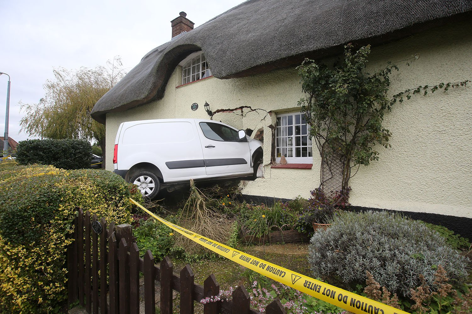 """south beds news agency-luton-(fairleys)...vna and cottage From: Fairley of Luton South Beds News Agency/Fairley of Luton Tel: 01582 572222 Email: southbedsnews@btconnect.com A driver who was high on cocaine could have killed a couple when he ploughed a white van into their thatched cottage. Jamie Gilroy, 35, came off a bend, crossed a grass verge, and went through a hedge before embedding the Berlingo van in the front of the 16th-century ??500,000 listed cottage. At Luton crown crown court on Friday, Gilroy of Harrow Piece, Maulden, Beds was jailed for 14 months and banned from driving for 60 months, from the time he is released from prison. He pleaded guilty to dangerous driving. The crash happened at about a quarter to eleven at night as Steven and Val Fossey were about to go to bed at their home Willow End on Ampthill Road in Maulden. Neighbours heard the noise and held Gilroy who had tried to escape. They tied up his legs with string until the police arrived. At the time Val, 67, said: """"We were in the living room at about a quarter to eleven. I was about to go up to bed, but my husband said to watch the end of the news. """"There was a dreadful noise - like an earthquake. This van came flying over a hedge and crashed into our hall and kitchen. If I had left the room I don't know what would have happened."""" Amazingly, Gilroy escaped unhurt from the wreckage. Val and Steve, a 66-year-old financial director, have lived in the pretty cottage for 14 years when the crash happened in October last year. Prosecutor Neil King said the repairs cost ??20,000. The couple had to pay their insurers at ??350 excess. They had to move out, but have now returned home. Val said: """"The driver got out of the van without a scratch. He was still in his work clothes. He tried to get away, but our neighbours held him until the police arrived. """"We are not right on the bend and we are about 20 yards from the road. He must have been going fast to go over the verge. One of"""