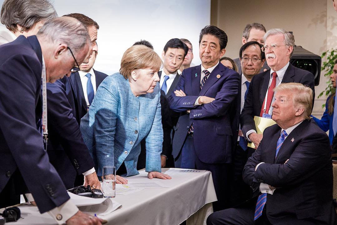 Picture posted on Angela Merkel's Instagram account shows the German chancellor surrounded by world leaders as she talks to President Trump (Picture: bundeskanzlerin/Instagram)