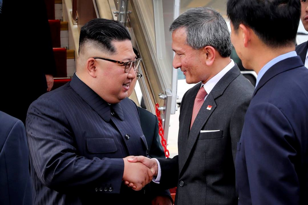 North Korea's leader Kim Jong Un shakes hands with Singapore's Foreign Minister Vivian Balakrishnan after arriving in Singapore June 10, 2018. Singapore's Ministry of Communications and Information/Handout via REUTERS ATTENTION EDITORS - THIS PICTURE WAS PROVIDED BY A THIRD PARTY. NO RESALES. NO ARCHIVE