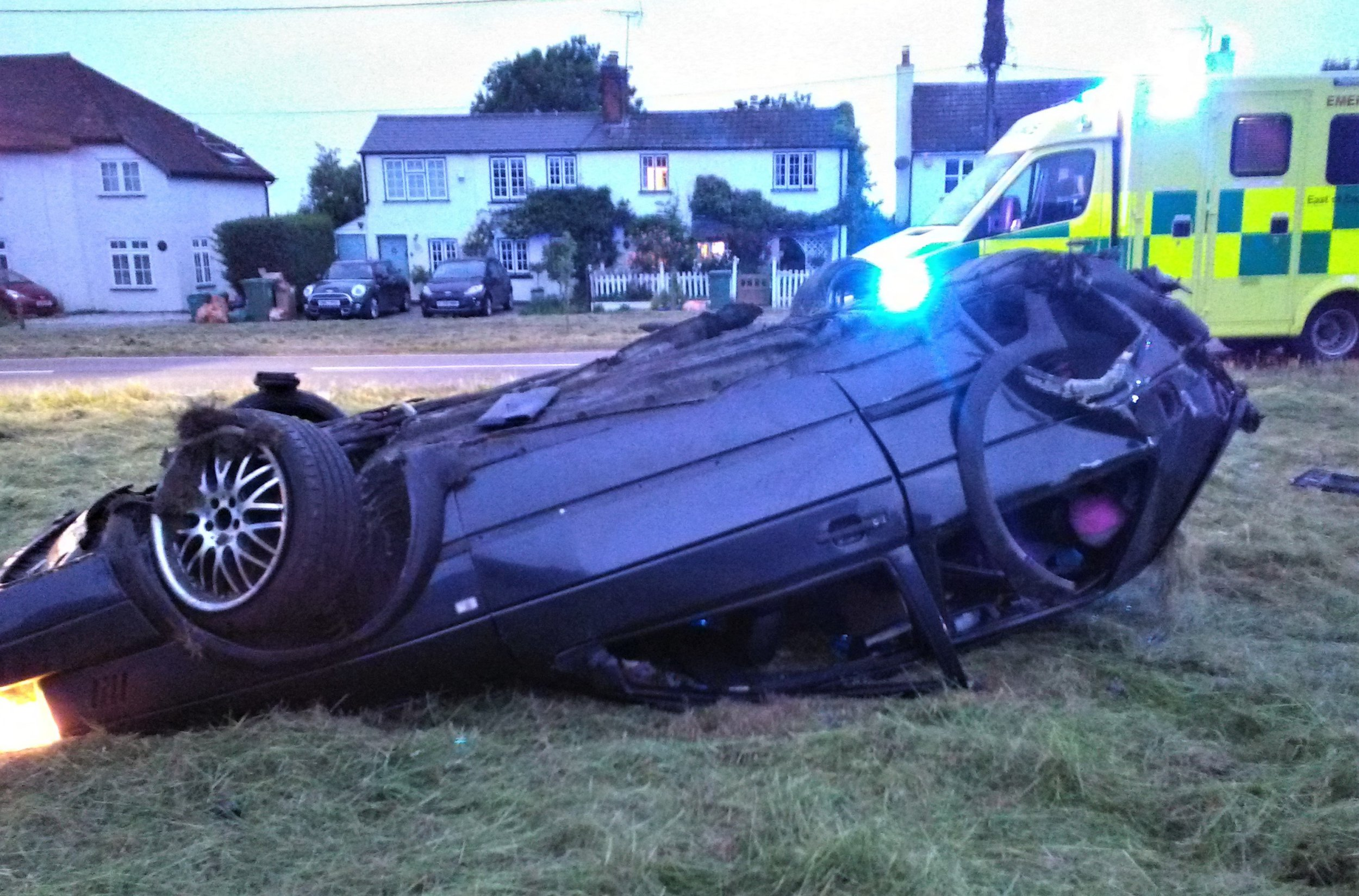 "The crashed car after hitting a deer in Navestock Side, Essex. See Masons copy MNDEER: A retired policeman has described the moment he rushed to help a couple whose car ""somersaulted three times"" after ""hitting a deer"" in the road. Rob Tyzack, 71, said he woke in the night to the sound of three louds bangs and ""screaming"" to see the wreckage of a car on the cricket pitch near his house. The trained medic ran out to find a young man lying unconscious on the ground and a woman crying by the upturned vehicle surrounded by debris."