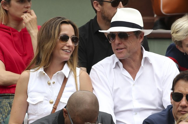 PARIS, FRANCE - JUNE 10: Hugh Grant and his wife Anna Eberstein during the men's final on Day 15 of the 2018 French Open at Roland Garros stadium on June 10, 2018 in Paris, France. (Photo by Jean Catuffe/Getty Images)
