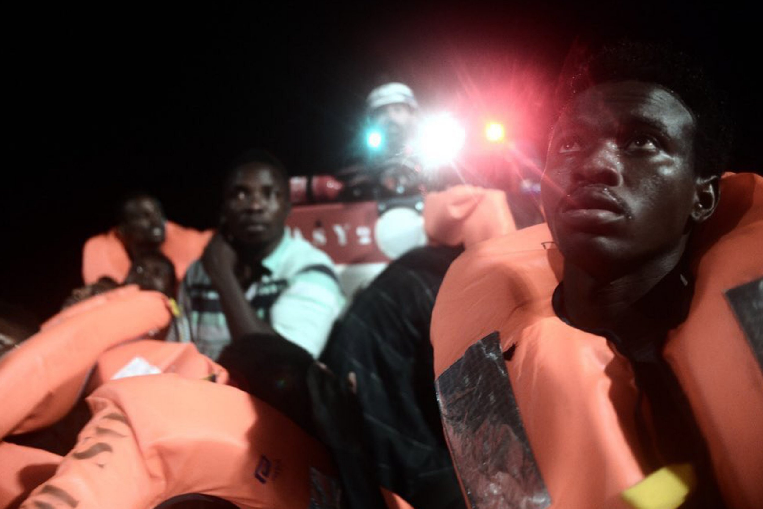 """CORRECTS NAME OF BOAT This undated photo released by by French NGO """"SOS Mediterranee"""" on Monday June 11, 2018 and posted on it's Twitter account, shows migrants about to board SOS Mediterranee's Aquarius ship and MSF (Doctors Without Borders) NGOs, in the Mediterranean Sea. Italy and Malta dug in for a second day and refused to let the rescue ship Aquarius with 629 people aboard dock in their ports, leaving the migrants at sea as a diplomatic standoff escalated under Italy's new anti-immigrant government. (Kenny Karpov/SOS Mediterranee via AP)"""