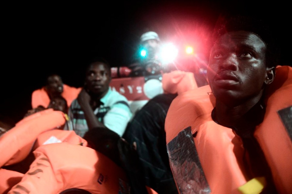 "CORRECTS NAME OF BOAT This undated photo released by by French NGO ""SOS Mediterranee"" on Monday June 11, 2018 and posted on it's Twitter account, shows migrants about to board SOS Mediterranee's Aquarius ship and MSF (Doctors Without Borders) NGOs, in the Mediterranean Sea. Italy and Malta dug in for a second day and refused to let the rescue ship Aquarius with 629 people aboard dock in their ports, leaving the migrants at sea as a diplomatic standoff escalated under Italy's new anti-immigrant government. (Kenny Karpov/SOS Mediterranee via AP)"