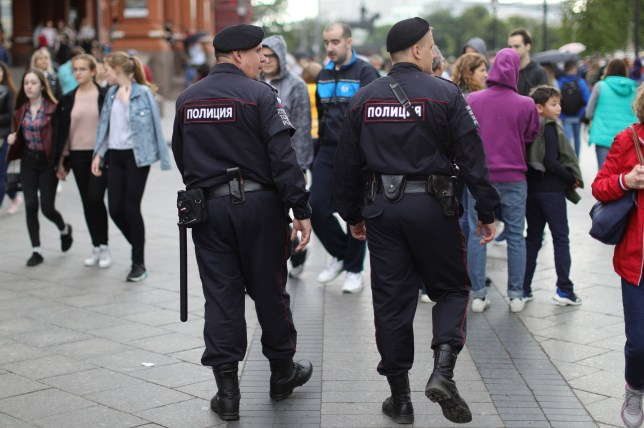 Two Russian police officer near Red Square in Moscow, Russia, ahead of the the run up to the first game of the 2018 World Cup. PRESS ASSOCIATION Photo. Picture date: Monday June 11, 2018. See PA story SPORT WorldCup. Photo credit should read: Aaron Chown/PA Wire