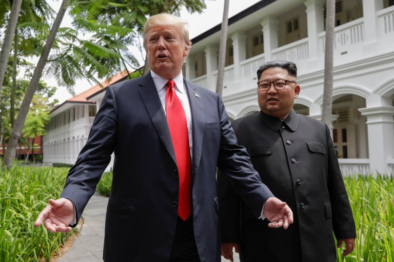 U.S. President Donald Trump and North Korea leader Kim Jong Un stop to talk with the media as they walk from their lunch at the Capella resort on Sentosa Island Tuesday, June 12, 2018 in Singapore. (AP Photo/Evan Vucci)