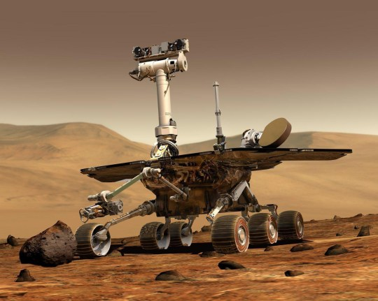 Undated NASA handout image of a Mars Rover. NASA's Mars rover 'Opportunity' managed to climb up and out of the crater that it explored for nearly two months, Monday March 22, 2004, overcoming a slippery slope that left the vehicle spinning its wheels during an earlier attempt. Today's short drive across the sandy inner rim of Eagle Crater placed the rover outside the shallow depression for the first time since it landed on January 24. See PA Story US Mars. PA Photo: NASA.