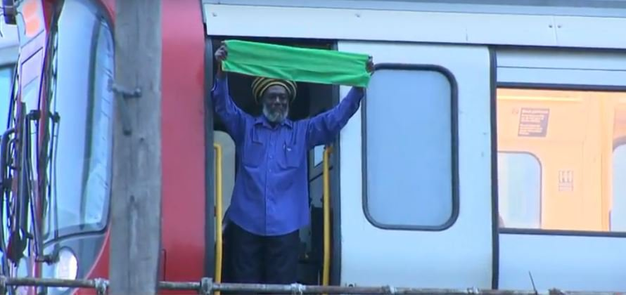 Tube driver stops train to wave green banner above Grenfell vigil
