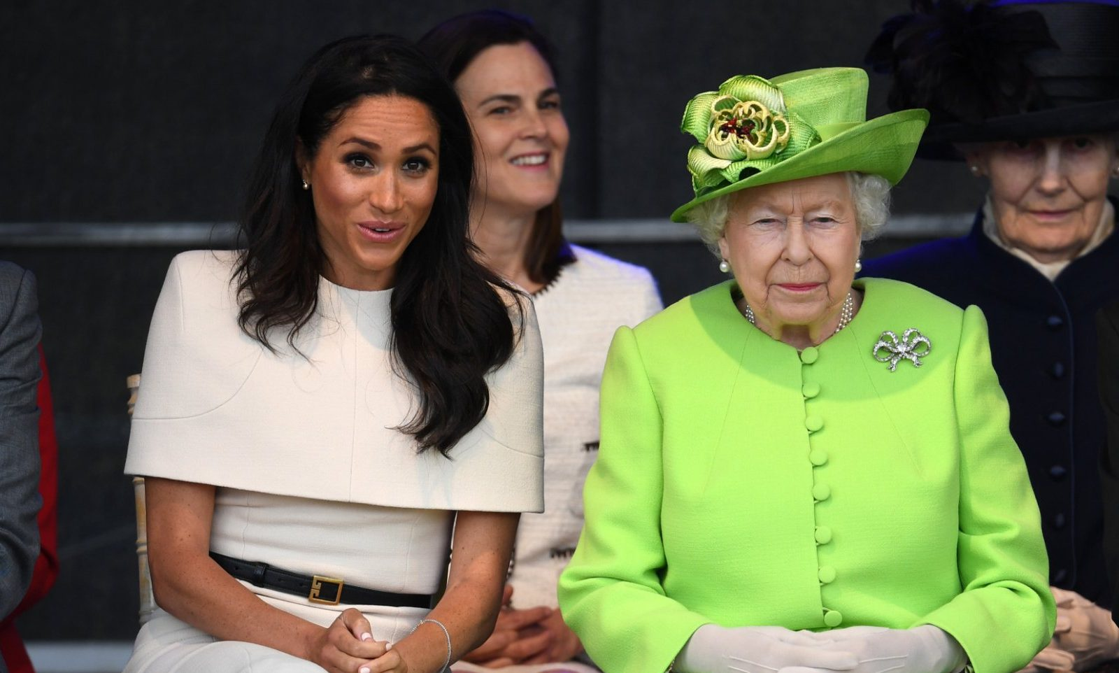 WIDNES, ENGLAND - JUNE 14: Queen Elizabeth II sits with Meghan, Duchess of Sussex during a ceremony to open the new Mersey Gateway Bridge on June 14, 2018 in the town of Widnes in Halton, Cheshire, England. Meghan Markle married Prince Harry last month to become The Duchess of Sussex and this is her first engagement with the Queen. During the visit the pair will open a road bridge in Widnes and visit The Storyhouse and Town Hall in Chester. (Photo by Jeff J Mitchell/Getty Images)