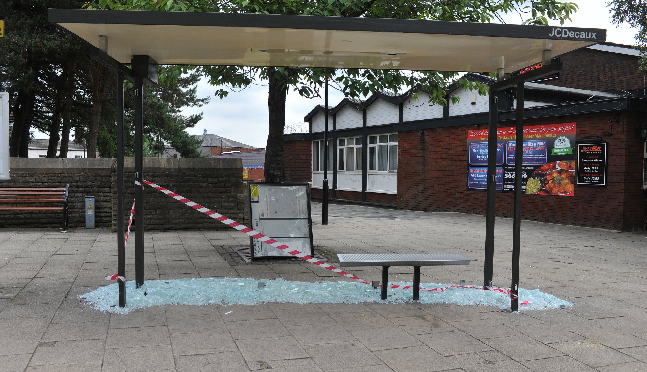 'Moronic' vandals rampaged through a town centre and smashed up a string of bus stops. The glass panels in five bus stops along Church Street and Market Street in Heywood, were shattered overnight on Tuesday. caption: The bus stop on Church Street in front of the Memorial Gardens