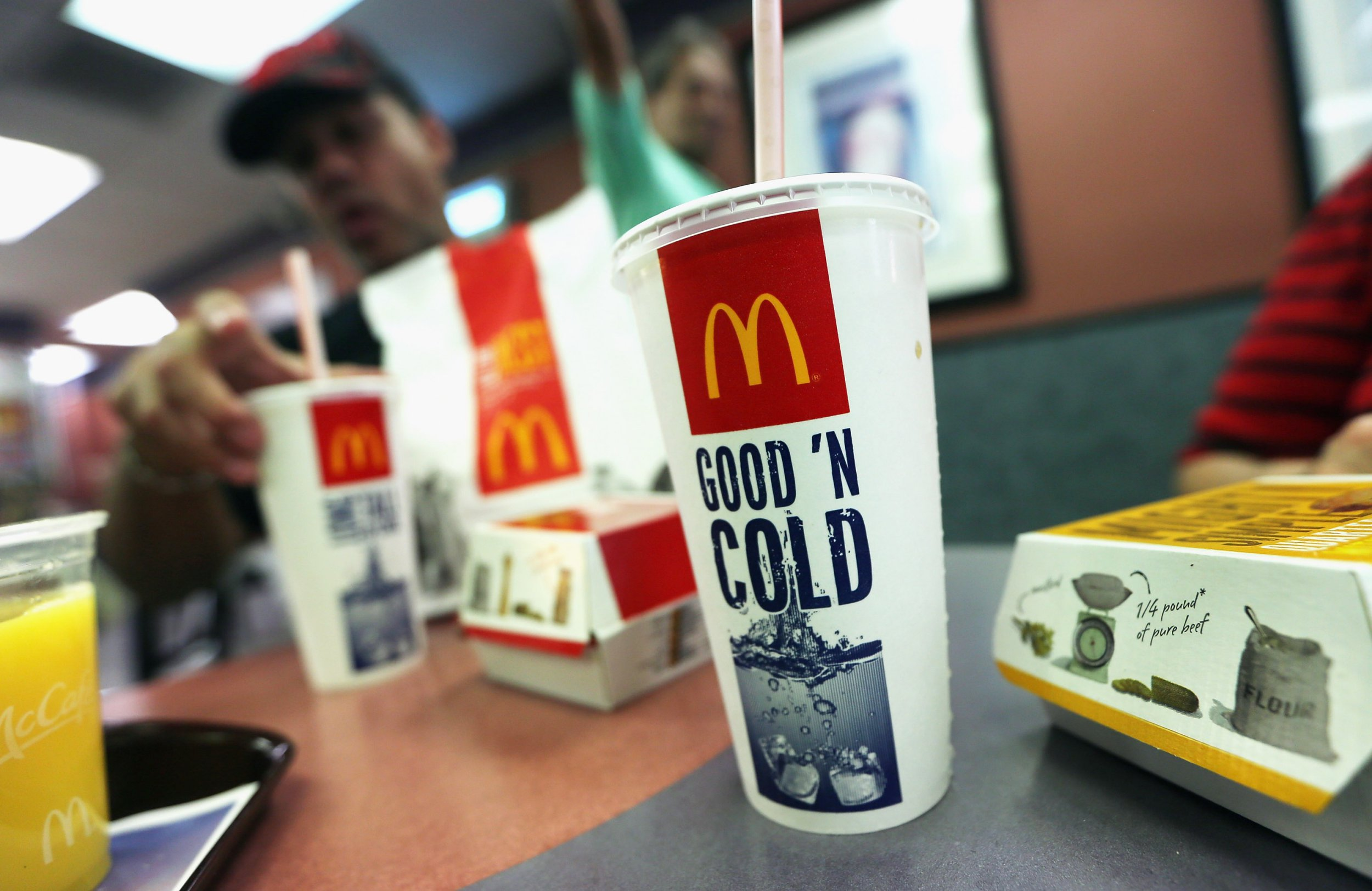 NEW YORK, NY - SEPTEMBER 13: A customer eats with a 21 ounce cups of soda at a Manhattan McDonalds on September 13, 2012 in New York City. In an effort to combat obesity, the New York City Board of Health voted to ban the sale of large sugary drinks. The controversial measure bars the sale of sugar drinks larger than 16 ounces at restaurants and concessions. (Photo by Mario Tama/Getty Images)