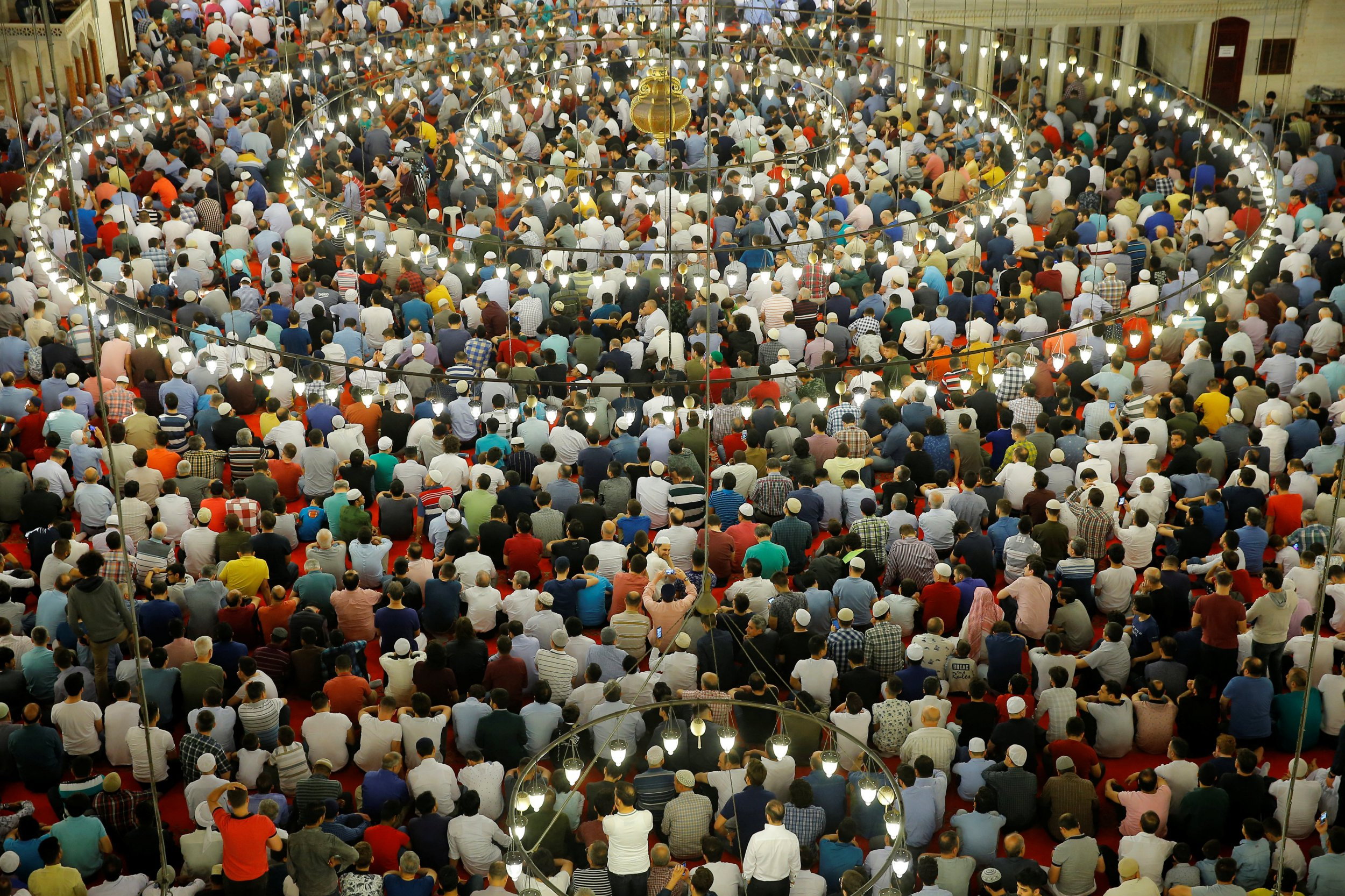 Worshippers pray during the first day celebration of Eid al Fitr at Suleymaniye Mosque in Istanbul, Turkey, June 15, 2018. REUTERS/Huseyin Aldemir