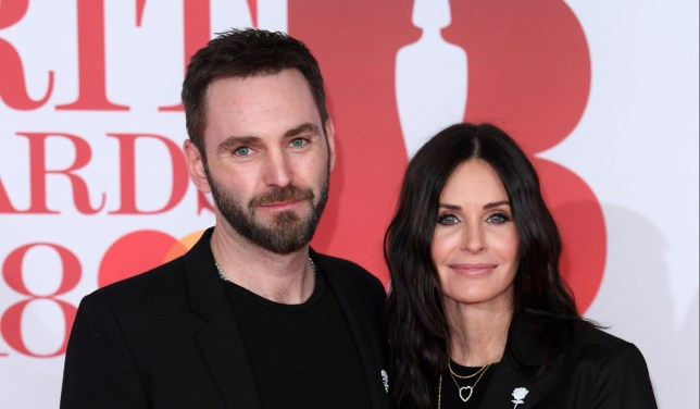 Mandatory Credit: Photo by David Fisher/REX/Shutterstock (9433573mc) Johnny McDaid and Courteney Cox 38th Brit Awards, Arrivals, The O2 Arena, London, UK - 21 Feb 2018