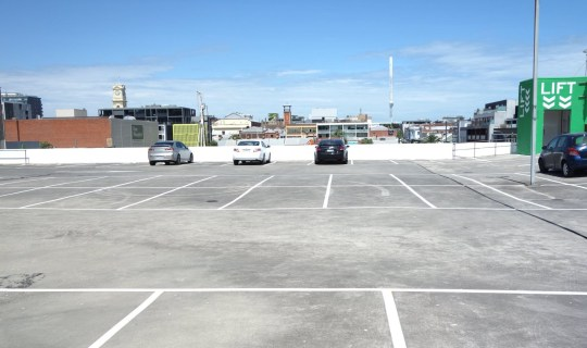 Woolworths allows mass nude photo shoot on car park rooftop