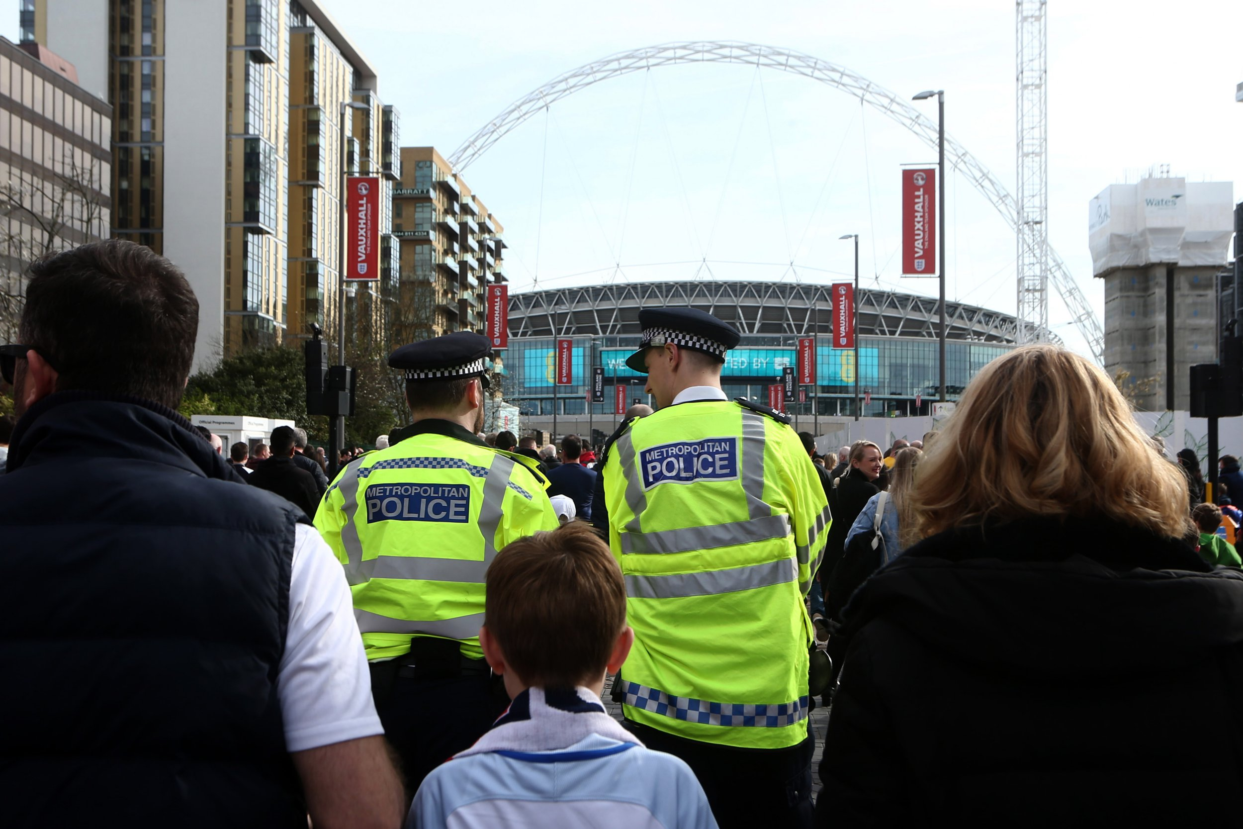 LONDON, ENGLAND - MARCH 26: Police officers patrol amongst the fans making their way to Wembley stadium ahead of the FIFA 2018 World Cup Qualifier between England and Lithunania at Wembley Stadium on March 26, 2017 in London, England. (Photo by Catherine Ivill - AMA/Getty Images)