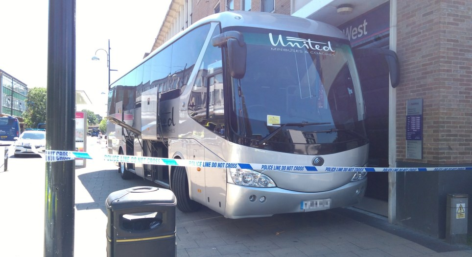 Panic set into pedestrians and bank workers this afternoon as a coach forced its way onto the pavement outside NatWest Bank in Crawley.
