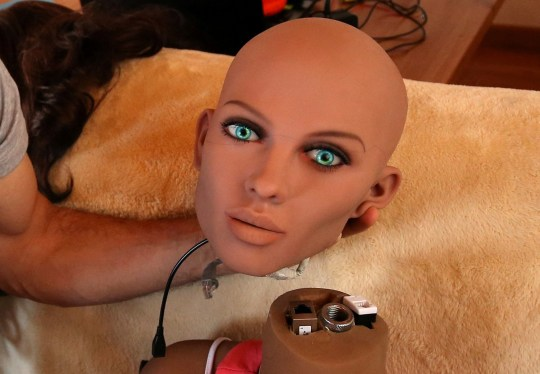 Catalan nanotechnology engineer Sergi Santos holds the head of Samantha, a sex doll packed with artificial intelligence providing her the capability to respond to different scenarios and verbal stimulus, in his house in Rubi, north of Barcelona, Spain, March 31, 2017. Picture taken March 31, 2017. REUTERS/Albert Gea TPX IMAGES OF THE DAY - RC1C68D75260
