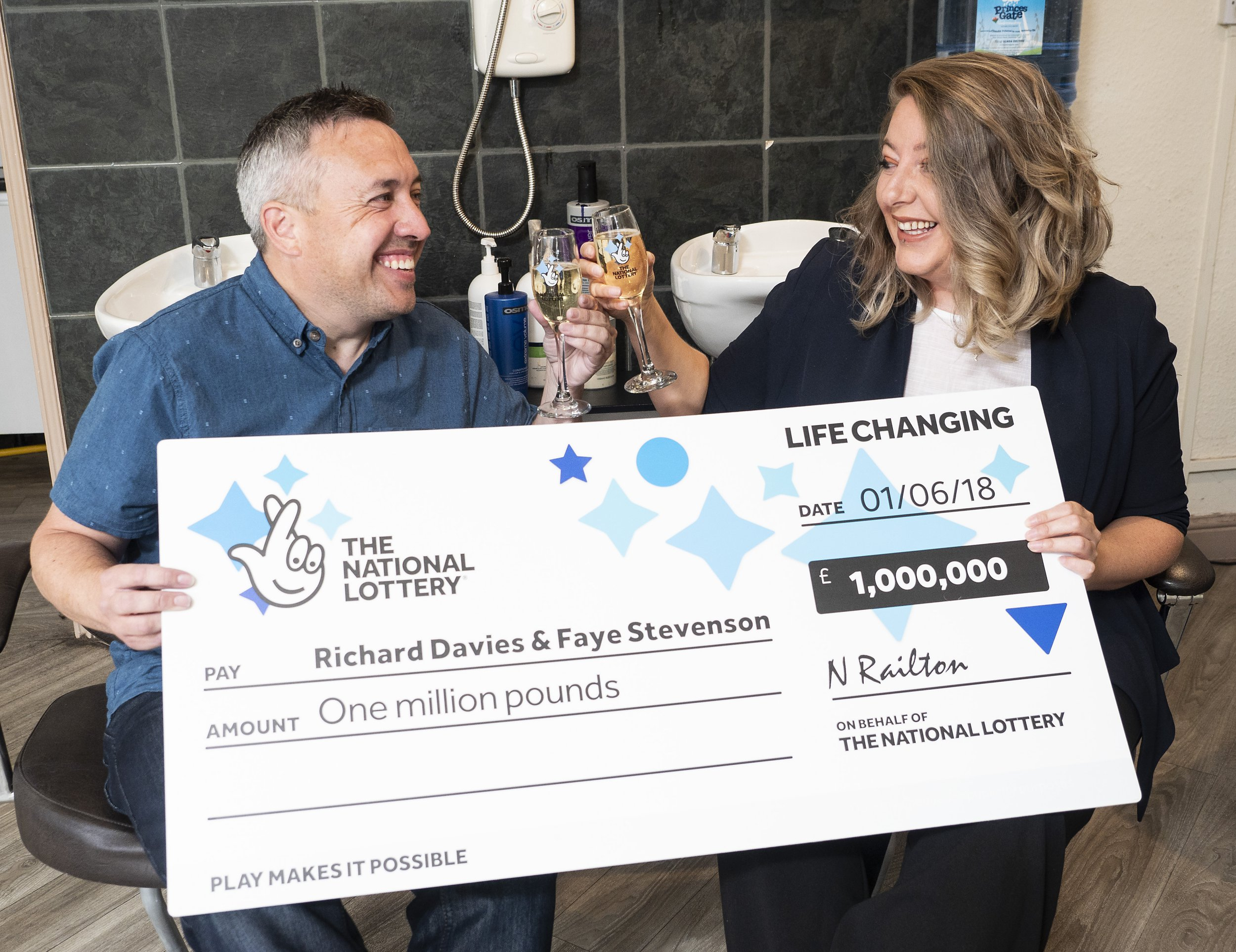 A lucky lottery millionaire's car broke down on his way to collect his ??1m - so he splashed out on AA membership to get his winnigs Hairdresser Richard Davies, 41, was delighted to hit the ??1m Euromillions jackpot but was told their village shop was too small to payout. So Richard and partner Faye Stevenson, 36, agreed to drive 180 miles from Brecon, Mid Wales, to the Camelot winners lounge in Watford. Pictured here is Richard Davies & his Nurse partner Faye Stevenson. ?? Tim Dickenson/WALES NEWS SERVICE