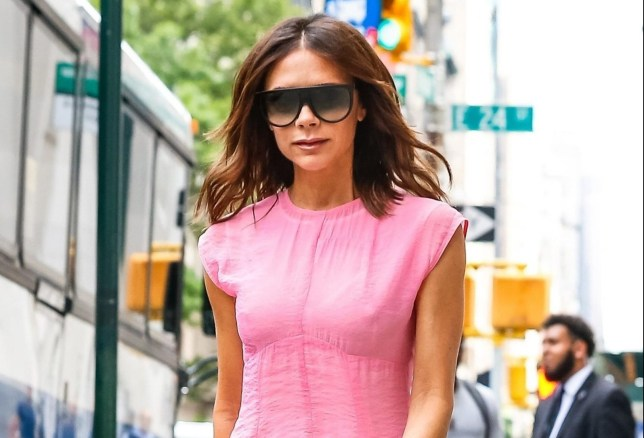 New York, NY - British fashion designer Victoria Beckham shows off her summer style in a pink dress paired with blue heels while leaving her hotel in the Big Apple. Pictured: Victoria Beckham BACKGRID USA 19 JUNE 2018 USA: +1 310 798 9111 / usasales@backgrid.com UK: +44 208 344 2007 / uksales@backgrid.com *UK Clients - Pictures Containing Children Please Pixelate Face Prior To Publication*