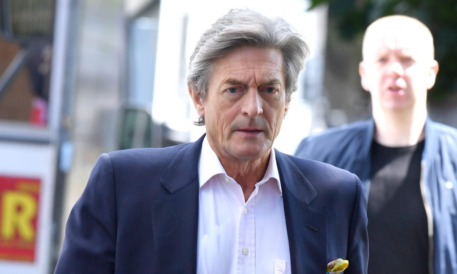 Pics Paul Cousans/Zenpix Ltd Corrie.. Cad Lewis(Nigel Havers) looks like he is back on the scene trying to woo Audrey(Sue Nicholl) .Audrey let Lewis go free when he as involved in a tussle with Roy Cropper. Audrey was heard saying 'he overpowered me'when daughter Gail returned to the car that Lewis was 'handcuffed' to. It seems that Audrey was not too keen to be seen though as she arrived on location shrouded in a headscarf. May be she is too embarrassed to be seen with suave Lewis
