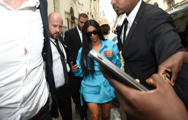 Kim Kardashian and Kanye West leave the Louis Vuitton fashion show and arrive at l'Avenue restaurant in Paris, France. Pictured: Kim Kardashian,Kanye West Ref: SPL5005409 210618 NON-EXCLUSIVE Picture by: E-Press / SplashNews.com Splash News and Pictures Los Angeles: 310-821-2666 New York: 212-619-2666 London: 0207 644 7656 Milan: +39 02 4399 8577 photodesk@splashnews.com Australia Rights, Germany Rights, Italy Rights, New Zealand Rights, United Kingdom Rights, United States of America Rights
