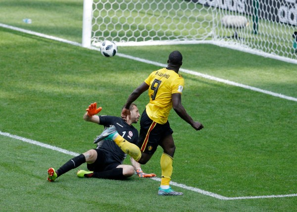 Belgium's Romelu Lukaku, right, scores his side's third goal against Tunisia goalkeeper Farouk Ben Mustapha during the group G match between Belgium and Tunisia at the 2018 soccer World Cup in the Spartak Stadium in Moscow, Russia, Saturday, June 23, 2018. (AP Photo/Victor Caivano)