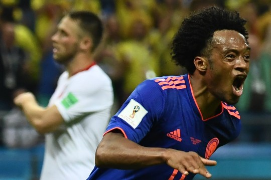 TOPSHOT - Colombia's forward Juan Cuadrado celebrates after scoring during the Russia 2018 World Cup Group H football match between Poland and Colombia at the Kazan Arena in Kazan on June 24, 2018. / AFP PHOTO / Jewel SAMAD / RESTRICTED TO EDITORIAL USE - NO MOBILE PUSH ALERTS/DOWNLOADSJEWEL SAMAD/AFP/Getty Images