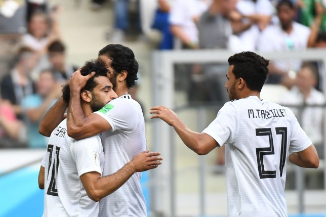 Egypt's forward Mohamed Salah (L) is congratulated by teammates after scoring during the Russia 2018 World Cup Group A football match between Saudi Arabia and Egypt at the Volgograd Arena in Volgograd on June 25, 2018. / AFP PHOTO / Philippe DESMAZES / RESTRICTED TO EDITORIAL USE - NO MOBILE PUSH ALERTS/DOWNLOADSPHILIPPE DESMAZES/AFP/Getty Images
