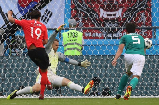 25a1867adc5 South Korea's Kim Young-gwon, left, scores his side's first goal past  Germany