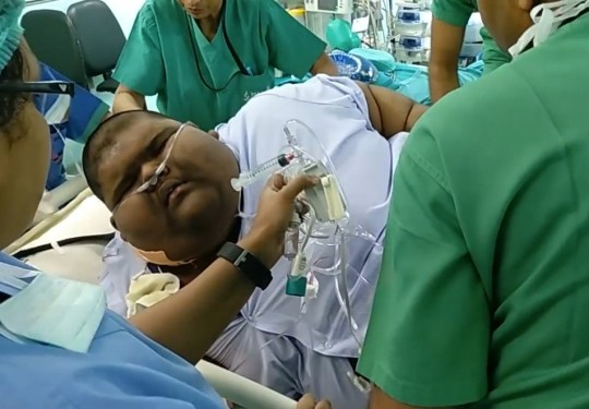 DELHI, INDIA - MAY 31, 2018: Mihir going into surgery on April 4, 2018, for a gastric bypass, at Max Hospital, Delhi, India. Mihir was the fattest teenager in the world weighing 237kgs in December 2017. But after a gastric bypass on April 4, 2018, he's already dropped to 172kgs and is still losing. He can finally walk unaided, and is looking forward to the day he can return to school and finish his studies. Pictures by: Cover Asia Press
