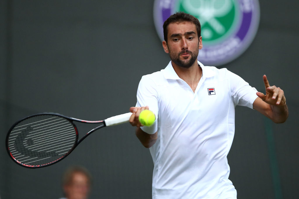 Marin Cilic suffers stunning Wimbledon exit to clear path for Roger Federer