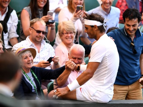 Rafael Nadal ends up on Wimbledon spectator's lap after sprinting into the crowd