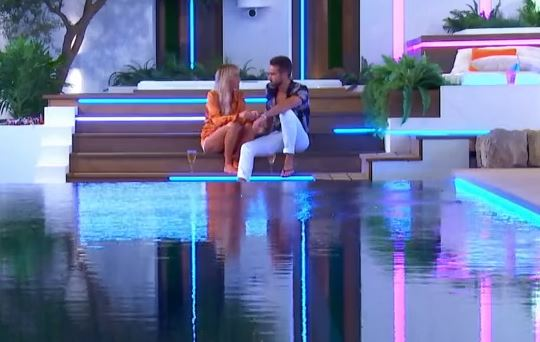 Laura and Paul talking on bottom step