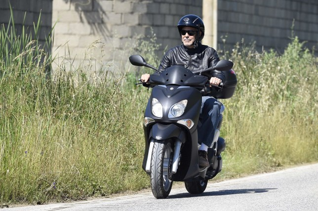 BGUK_1244527 - ** RIGHTS: ONLY UNITED KINGDOM ** Sardinia, ITALY - George Clooney enjoying a ride on a scooter in Sardinia, Italy. Pictured: George Clooney BACKGRID UK 24 MAY 2018 BYLINE MUST READ: CIAOPIX / FREZZA LAFATA / BACKGRID UK: +44 208 344 2007 / uksales@backgrid.com USA: +1 310 798 9111 / usasales@backgrid.com *UK Clients - Pictures Containing Children Please Pixelate Face Prior To Publication*