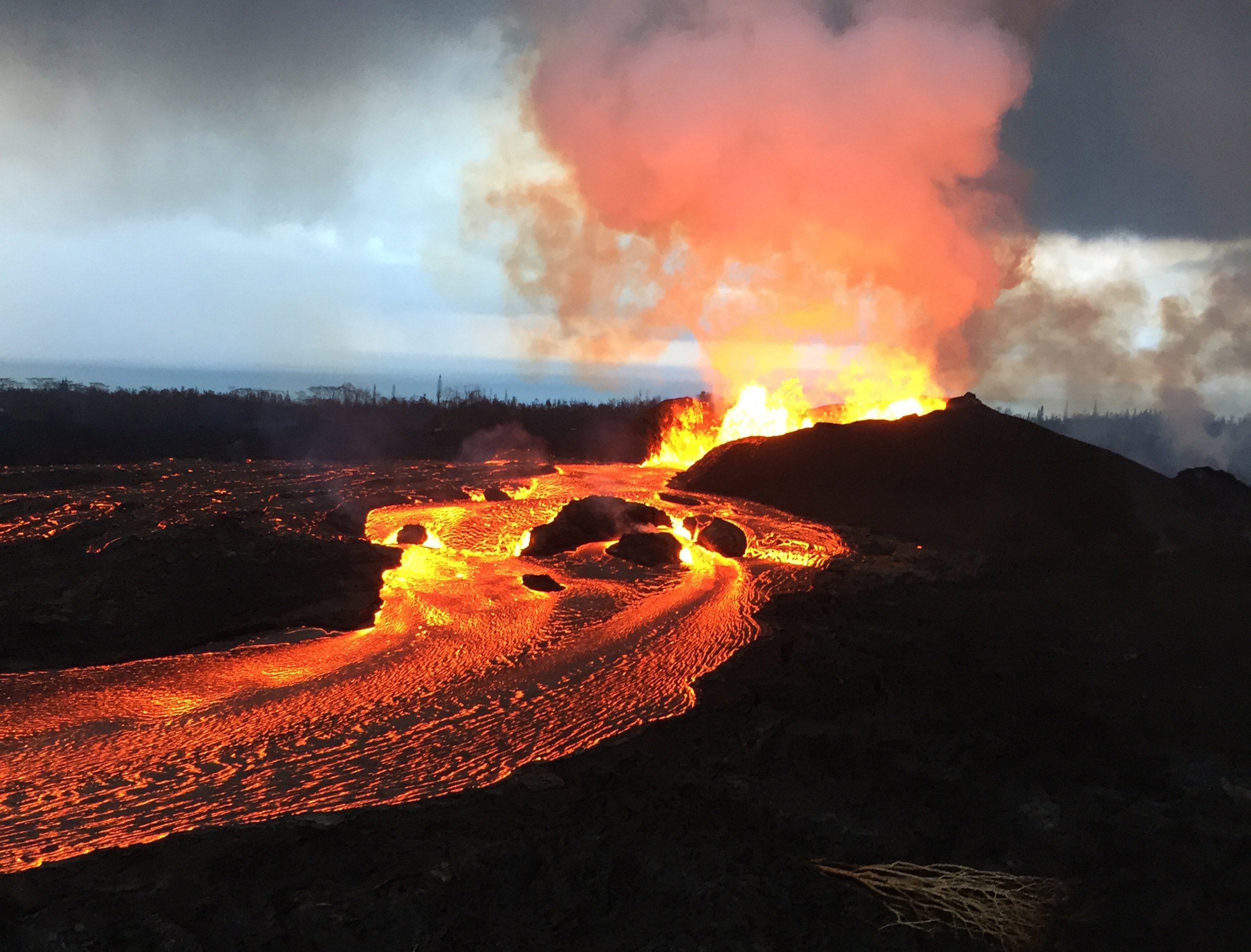 epa06805029 A handout photo made available by the United States Geological Survey (USGS) on 13 June 2018 shows Kilauea volcano's Fissure 8 fountains that reportedly reached heights up to 160 feet (48 meters) overnight, Hawaii, USA, 12 June 2108. Lava fragments falling from the fountains are building a cinder-and-spatter cone around the vent, with the highest part of the cone (about 125 feet high, 38 meters high) on the downwind side. EPA/USGS HANDOUT HANDOUT EDITORIAL USE ONLY/NO SALES