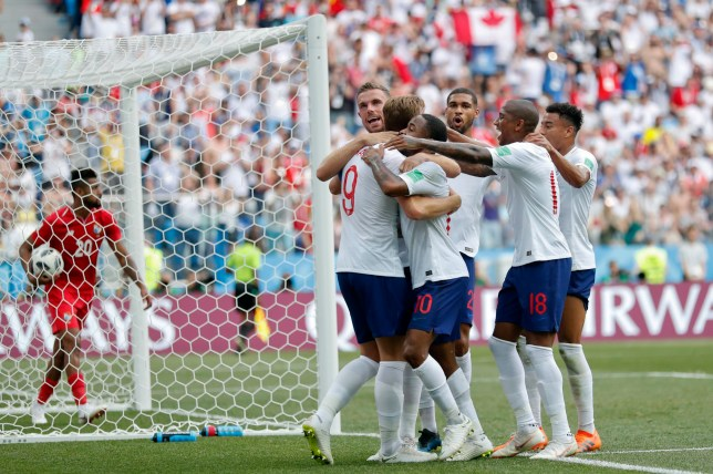 England players celebrate after their teammate Harry Kane scored their side's fith goal during the group G match between England and Panama at the 2018 soccer World Cup at the Nizhny Novgorod Stadium in Nizhny Novgorod , Russia, Sunday, June 24, 2018. (AP Photo/Antonio Calanni)