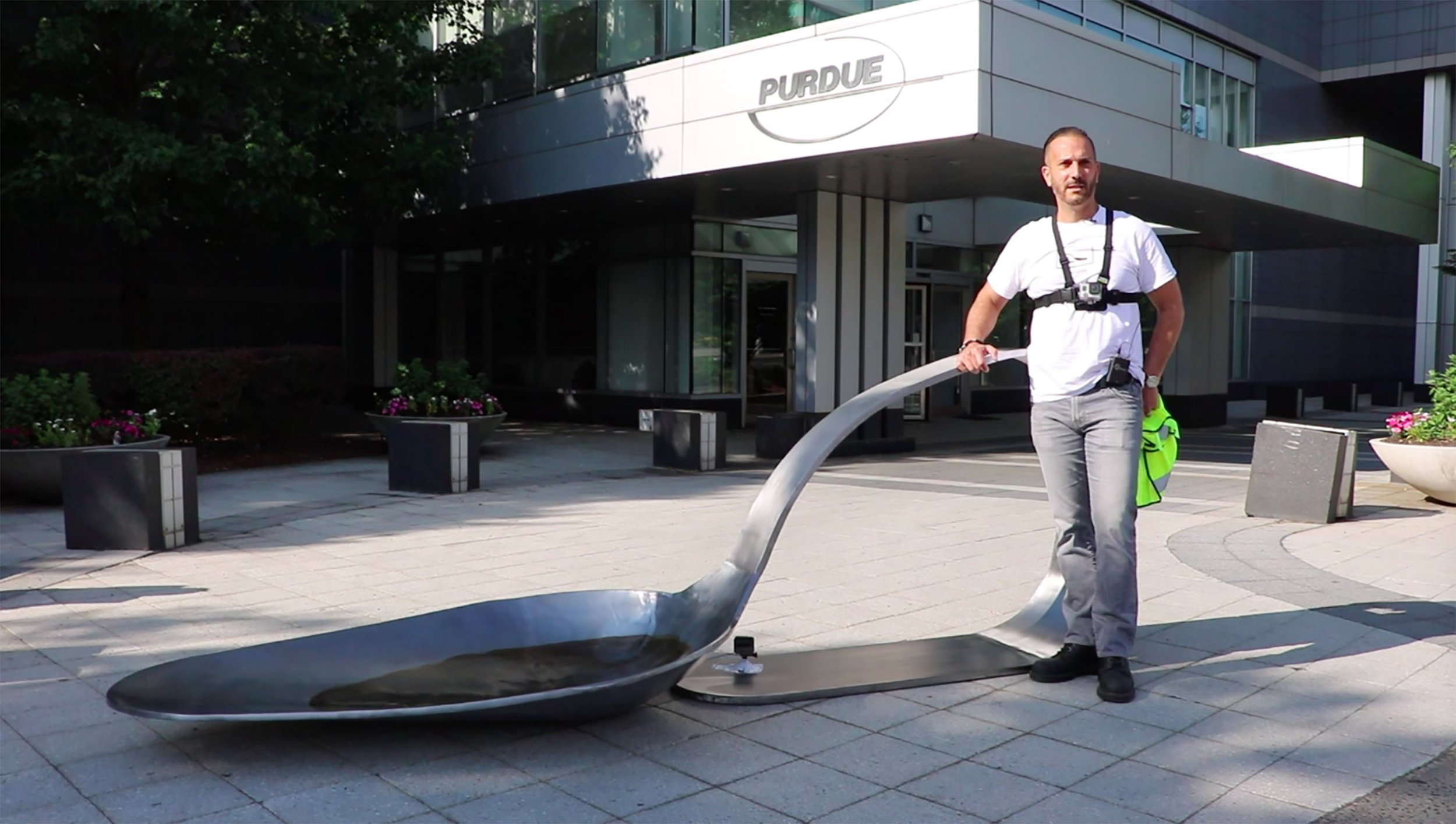 Gallery dealer gets arrested for placing a huge heroin spoon outside an opioid company