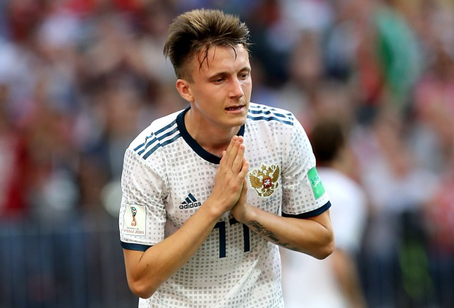 epa06855088 Aleksandr Golovin of Russia reacts during the FIFA World Cup 2018 round of 16 soccer match between Spain and Russia in Moscow, Russia, 01 July 2018. (RESTRICTIONS APPLY: Editorial Use Only, not used in association with any commercial entity - Images must not be used in any form of alert service or push service of any kind including via mobile alert services, downloads to mobile devices or MMS messaging - Images must appear as still images and must not emulate match action video footage - No alteration is made to, and no text or image is superimposed over, any published image which: (a) intentionally obscures or removes a sponsor identification image; or (b) adds or overlays the commercial identification of any third party which is not officially associated with the FIFA World Cup) EPA/MAHMOUD KHALED EDITORIAL USE ONLY EDITORIAL USE ONLY