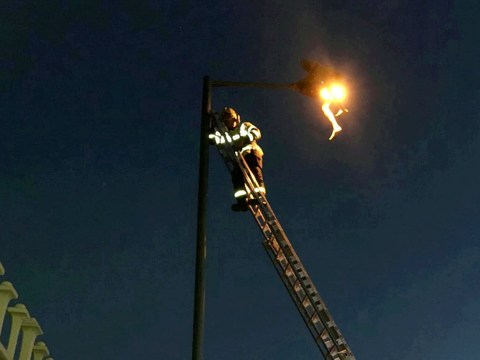 Man needs rescuing from 45ft lamppost 'after getting high while high on spice'