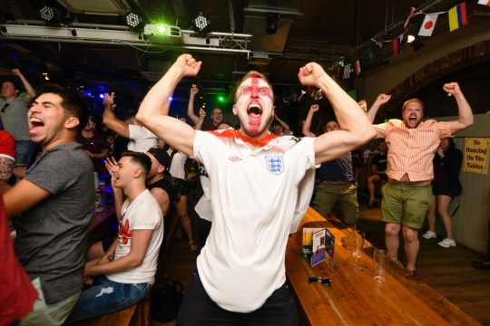 MERCURY PRESS. Liverpool, UK. 3/7/18. Pictured: England fans celebrate after their World Cup win over Colombia this evening in Bierkeller in Liverpool city centre