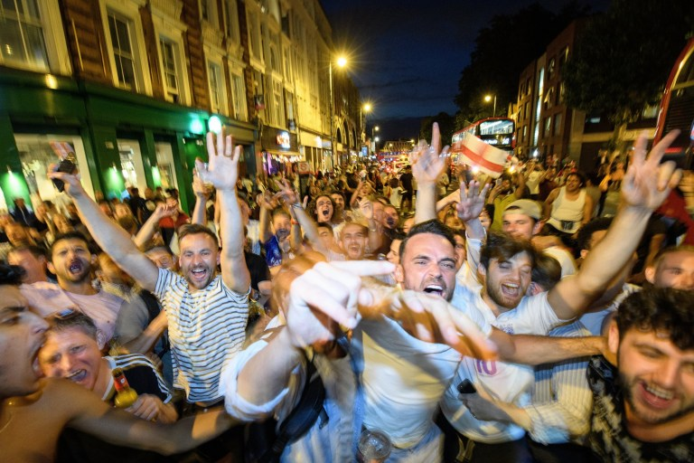 LONDON, ENGLAND - JULY 03: England fans celebrate in the streets after England win 4-3 on penalties, following the FIFA 2018 World Cup Finals match between Colombia and England in Russia, on July 3, 2018 in London, England. World Cup fever is building among England fans after reaching the Round of 16 in Russia. (Photo by Leon Neal/Getty Images)
